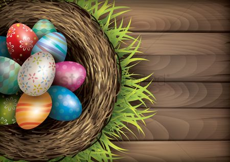 Greetings : Easter eggs in nest on wooden board