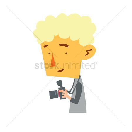 Photographers : Man holding a camera