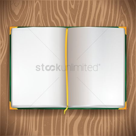 Journals : Opened book on wooden background