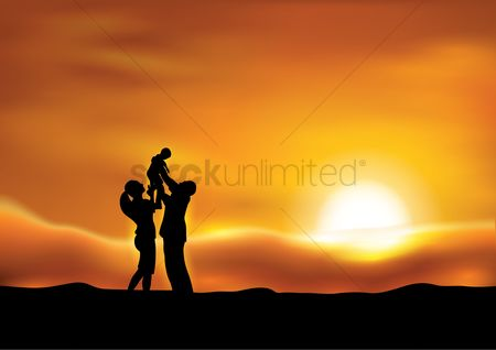Kids : Parents with a kid at sunset