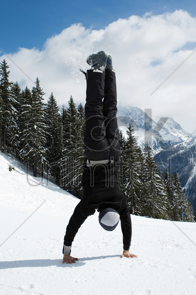 a man doing handstand stock photo
