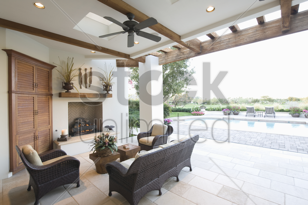 beamed poolside outdoor room stock photo