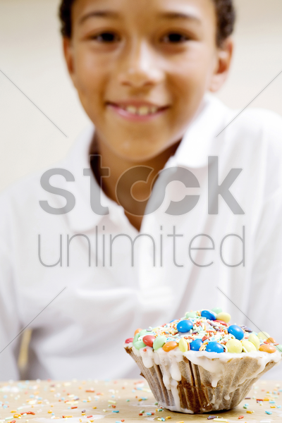 boy and a cup cake stock photo