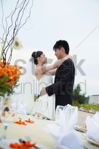 bride and groom at their wedding reception stock photo