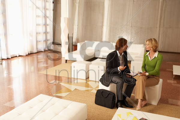 business couple talking in living room stock photo