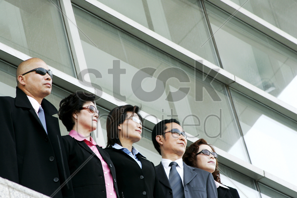 business people wearing sunglasses stock photo