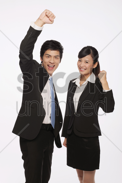 businessman and businesswoman celebrating their success stock photo