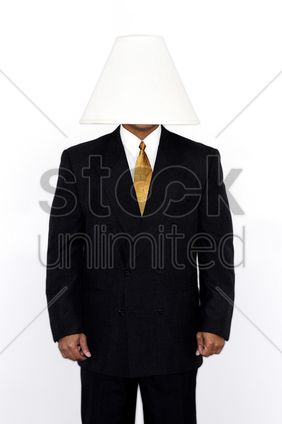 businessman with a lamp covering his head stock photo