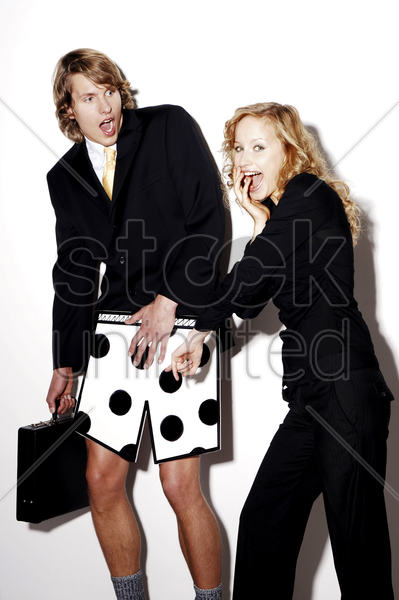 businesswoman laughing at her colleague stock photo