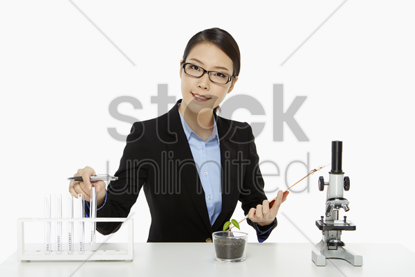 businesswoman sitting and checking the text tubes stock photo