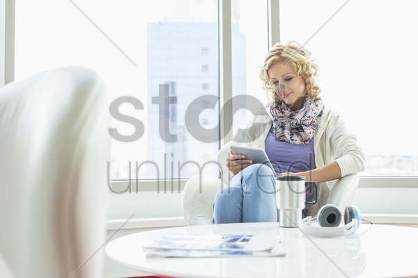 businesswoman using tablet pc at creative office lobby stock photo