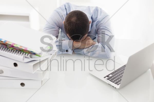 caucasian businessman asleep at his desk stock photo