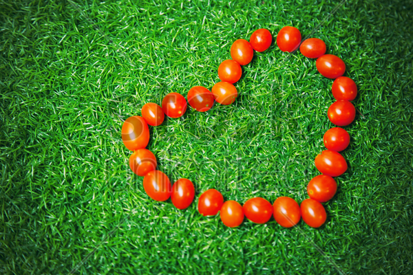 cherry tomatoes forming heart shape stock photo