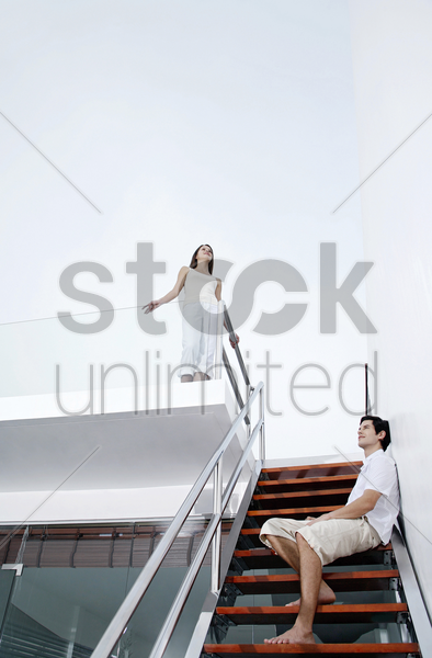 couple hanging around in the house stock photo