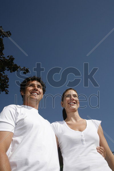 couple smiling while looking away stock photo