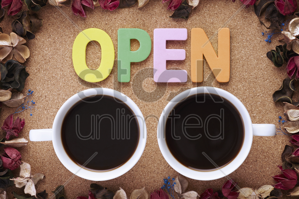 cup of coffees with open letters stock photo