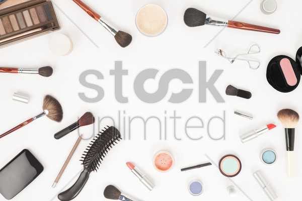 flatlay of makeup accessories stock photo