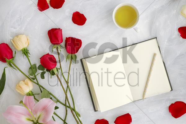 flatlay of white background with flowers stock photo