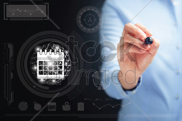hand holding a digital pen with calendar icon stock photo