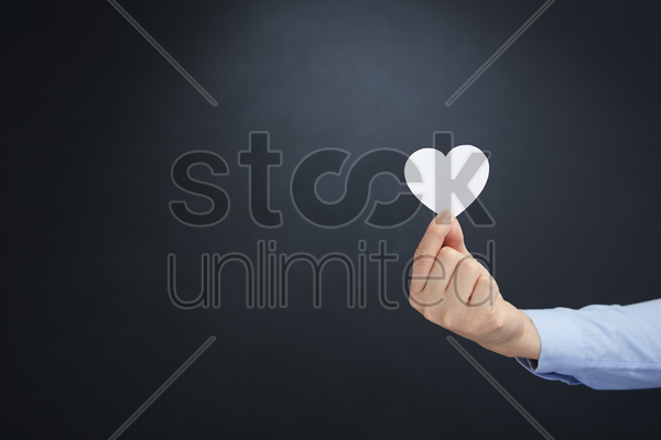 hand holding a heart stock photo