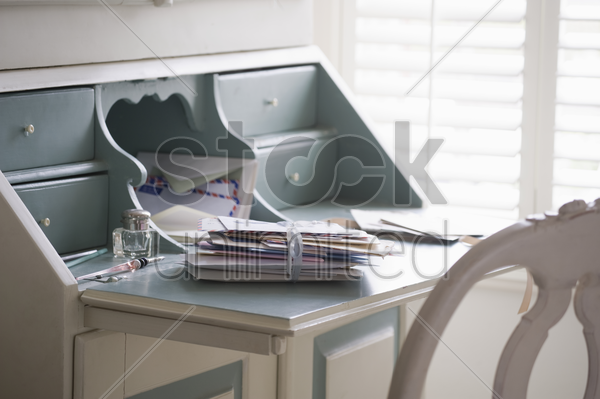 letters tied with ribbon on writing desk stock photo