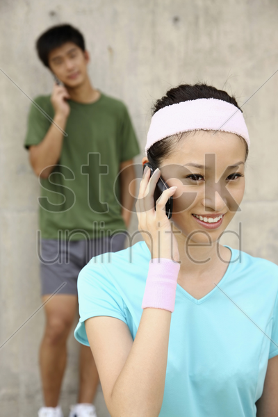 man and woman talking on the phone stock photo