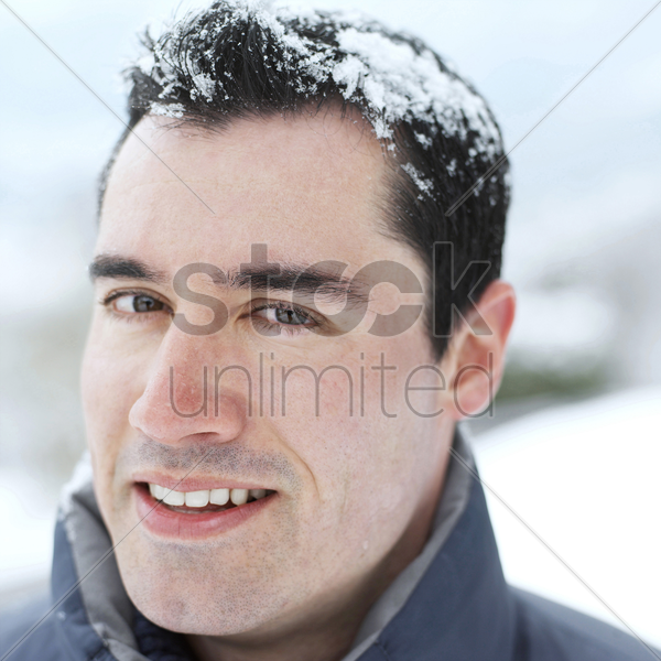 man smiling at the camera stock photo