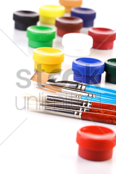 paint boxes and brushes on white background stock photo