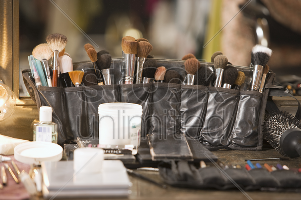 professional cosmetics brushes on dressing table stock photo