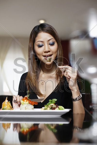woman eating her lunch stock photo