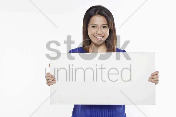 woman holding a blank placard stock photo