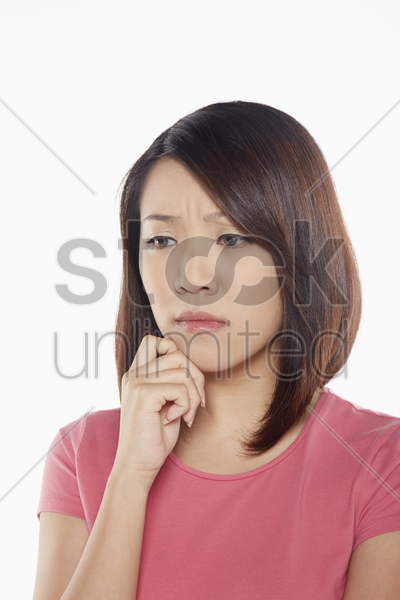 woman looking very sad stock photo