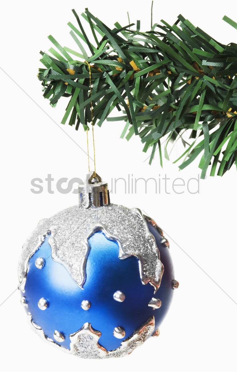 Blue Bauble Hanging On A Christmas Tree Stock Photo