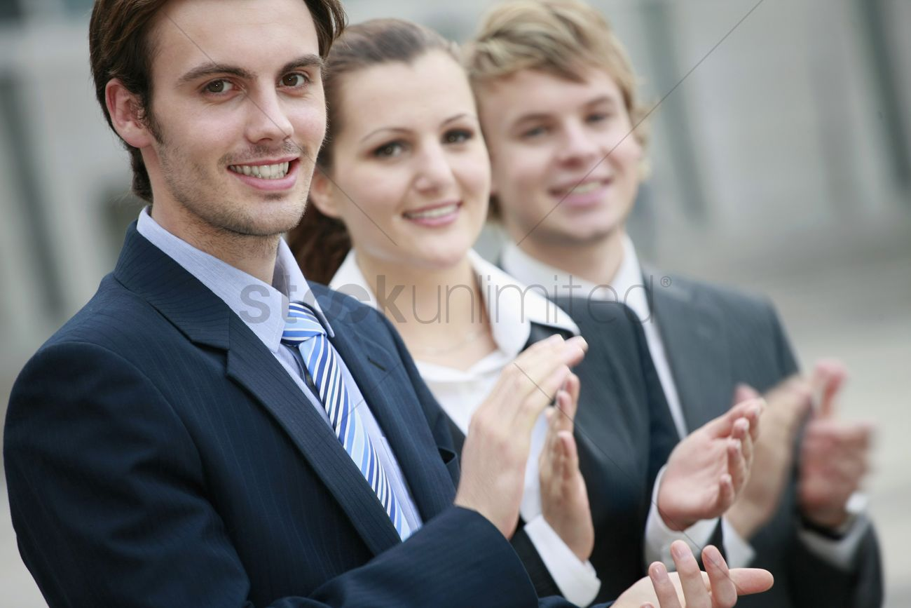 Business people clapping hands Stock Photo - 1846992