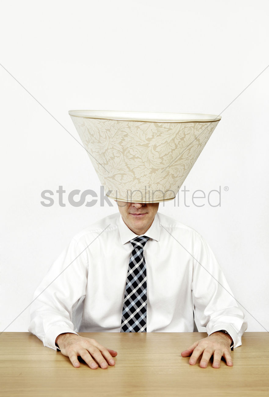 Lamp Shade On Head : Businessman with a lamp shade covering his head stock