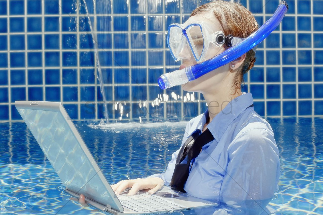 Businesswoman With Diving Mask Using Laptop In Swimming Pool Stock Photo 1842696 Stockunlimited