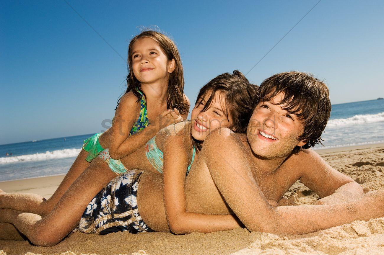 Children In Swimwear Playing Beach Stock Photo