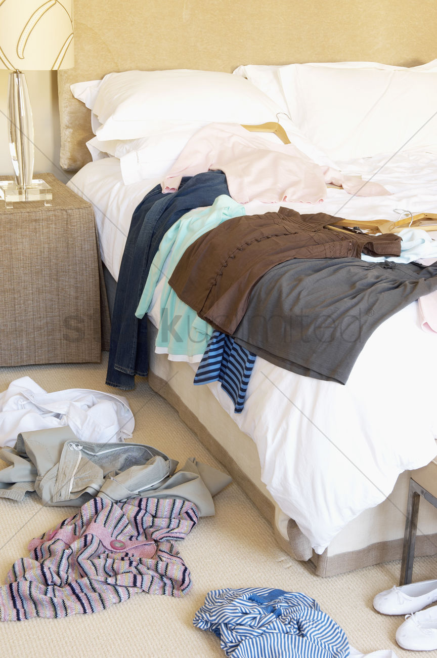 Clothes Scattered On Floor And Bed Of Hotel Room Stock