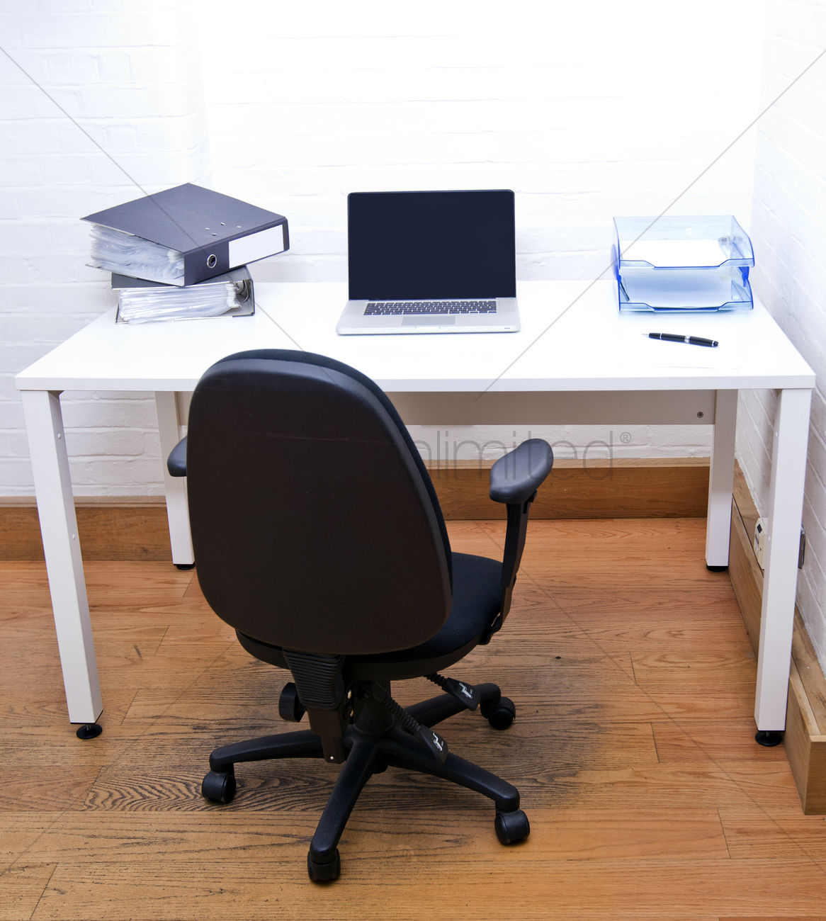 Empty Office Chair With Laptop On Desk Stock Photo 1924500 Stockunlimited