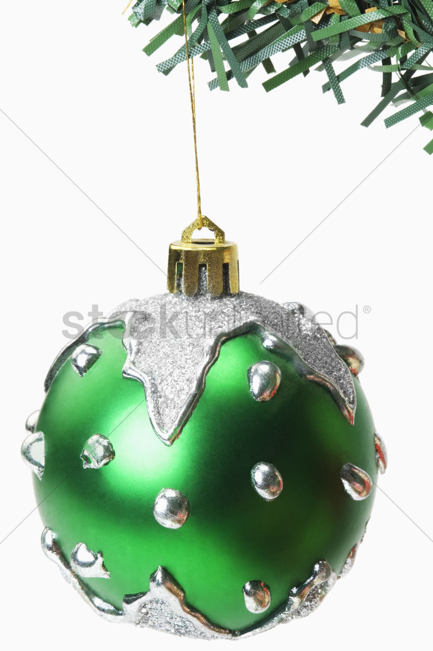 Green Bauble Hanging On A Christmas Tree Stock Photo