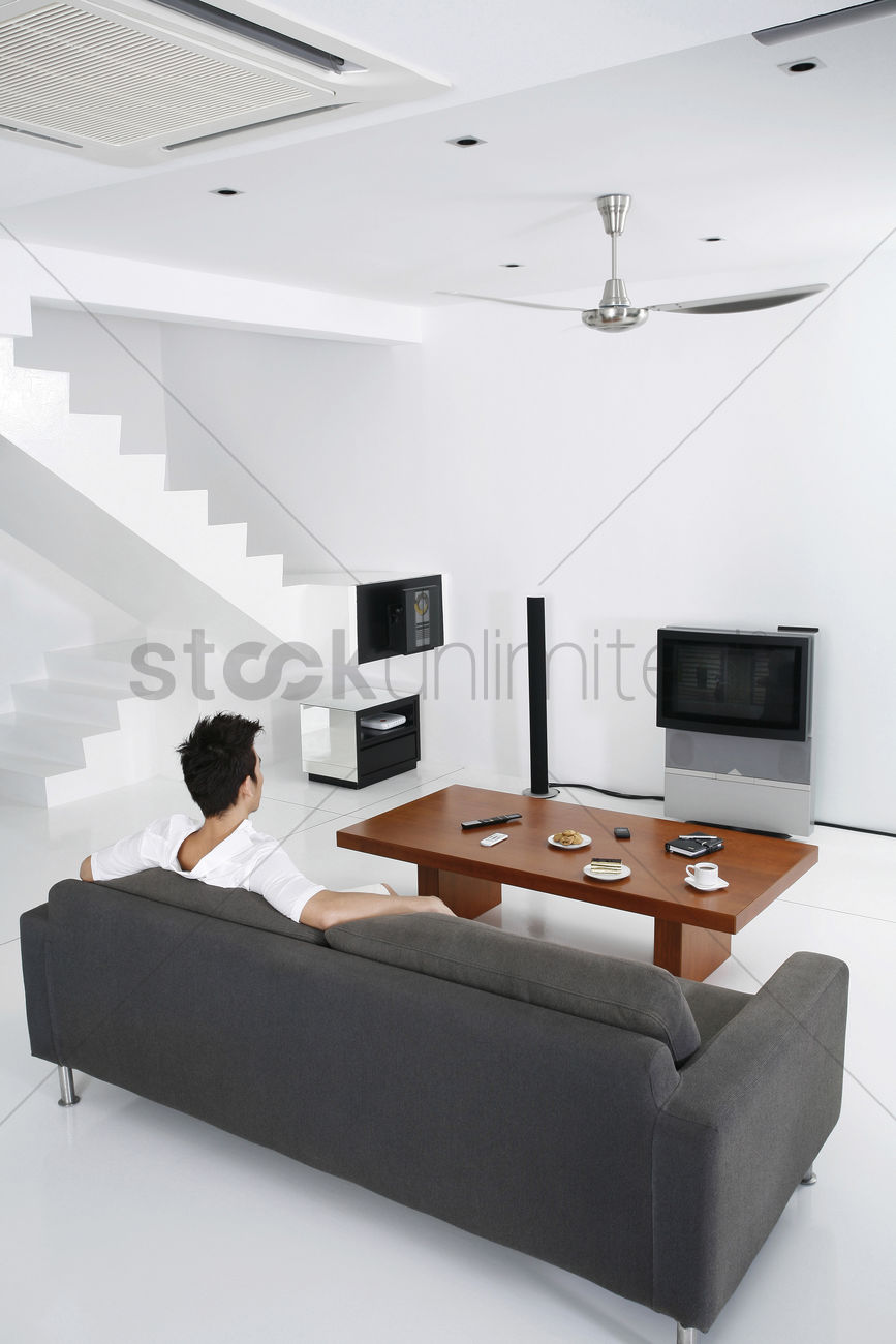 Guy in a spacious living room Stock Photo - 1703252 | StockUnlimited