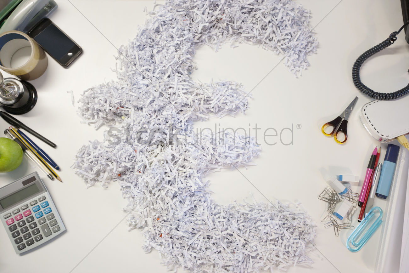 High Angle View Of Euro Sign Symbol With Other Office Stationery Supplies Stock Photo