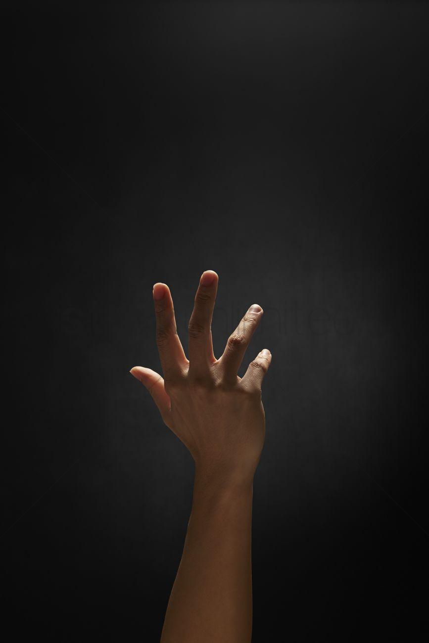 Human hand reaching ou...