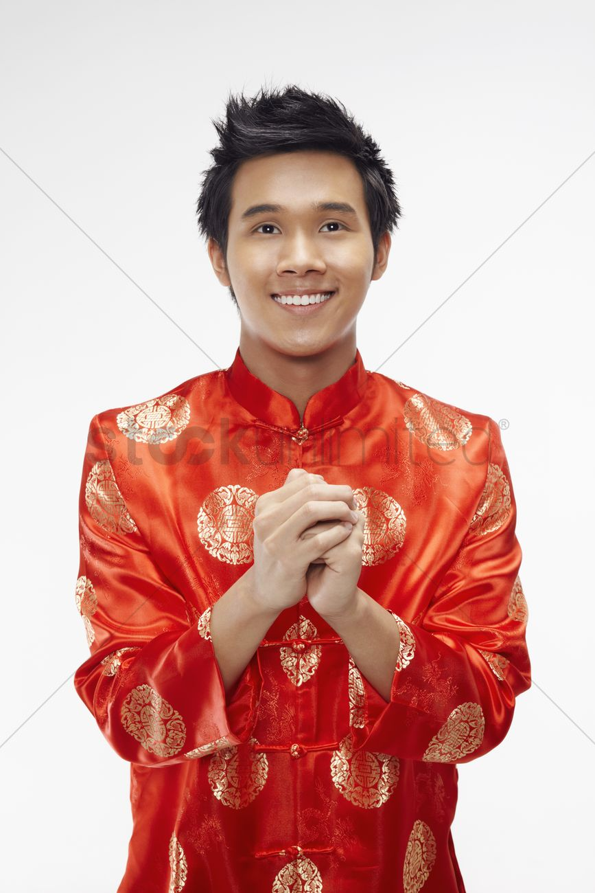Man in chinese traditional clothing showing greeting gesture stock man in chinese traditional clothing showing greeting gesture stock photo m4hsunfo