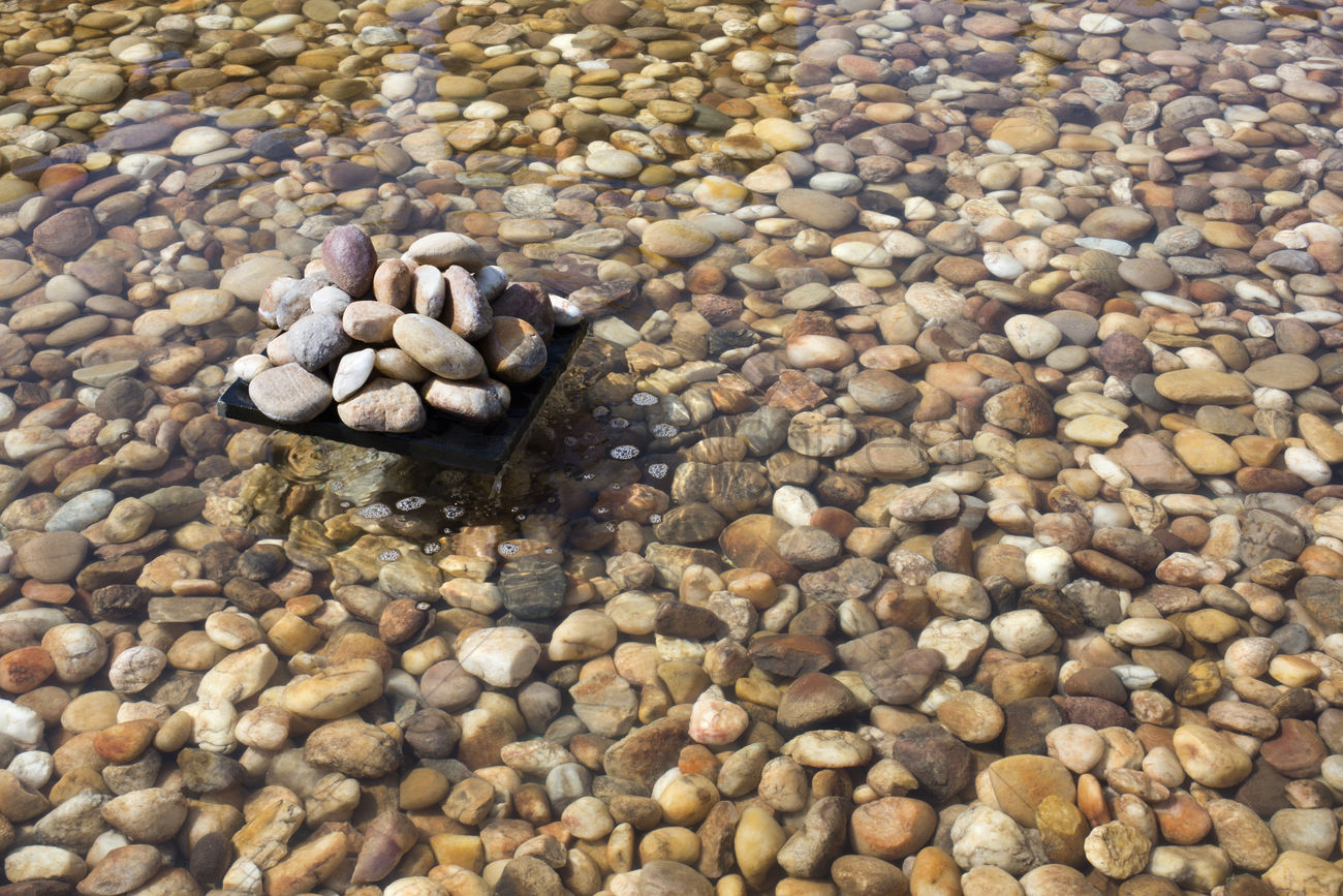 Pebbles in an artificial pond jaisalmer rajasthan india for Artificial pond