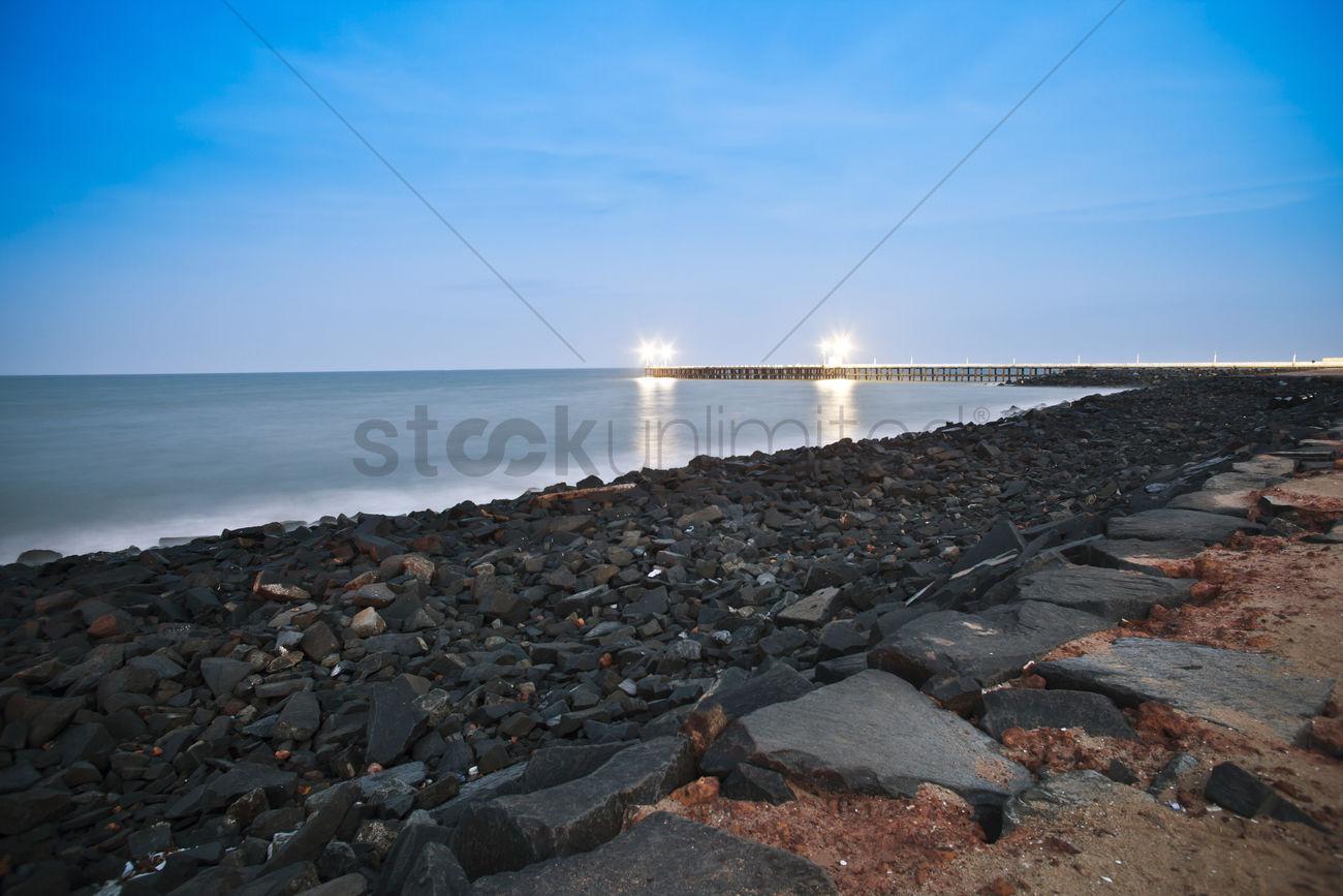 Rocks On Beach At Dusk Pondicherry India Stock Photo