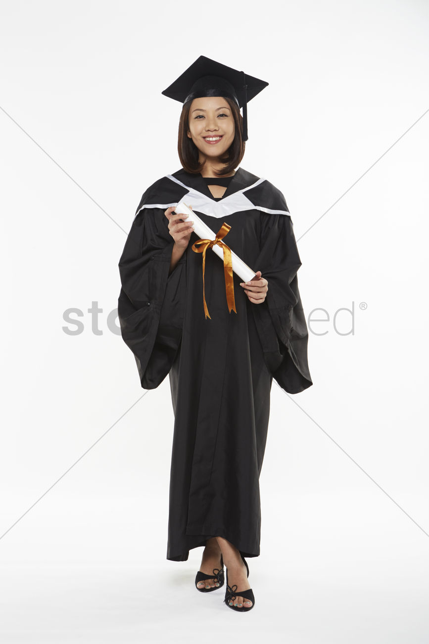 Woman in graduation gown holding a scroll Stock Photo - 1855728 ...