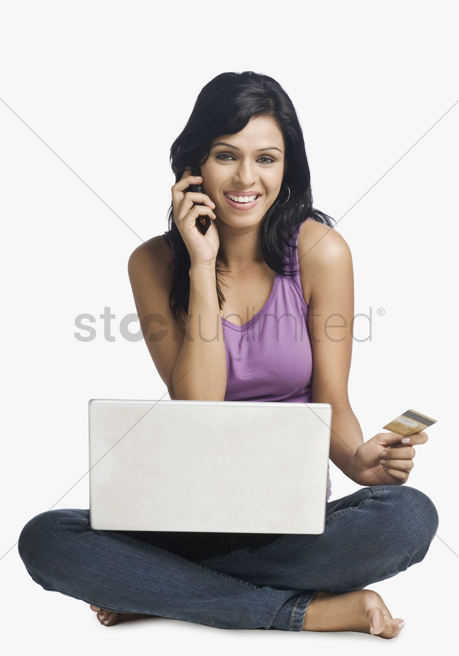Woman shopping online and talking on a mobile phone Stock ...