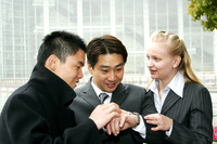 A group of business people looking at the time