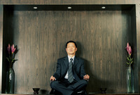 A man in business suit meditating
